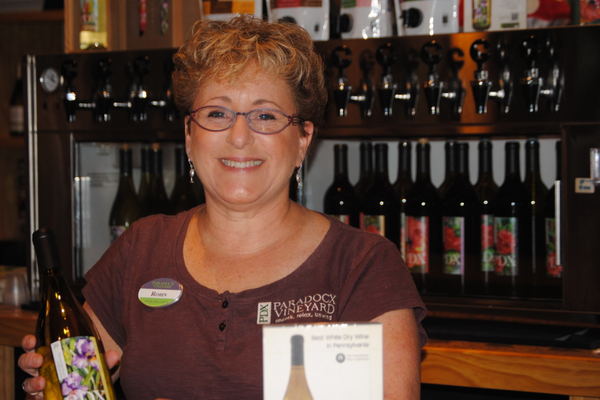 "Robin Densten, winetender at Paradocx Vineyard in The Market at Liberty Place: ""I love how quaint Kennett Square is. Every person that I've encountered who works here is very friendly. There's a camaraderie and cooperation among businesses."""