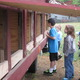 Young visitors look into the chicken coop.