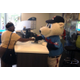 Pawtucket Red Sox mascot Paws assists a customer.