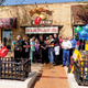 Mayor Joe Broda and Jim Miller of John Dough Bakery cut the ribbon celebrate the grand re-opening with Lisle Chamber members.