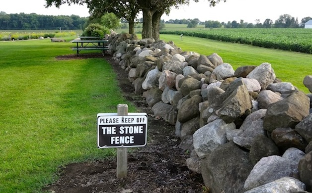 The stone fence is not for climbing, therefore your kids will want to climb.