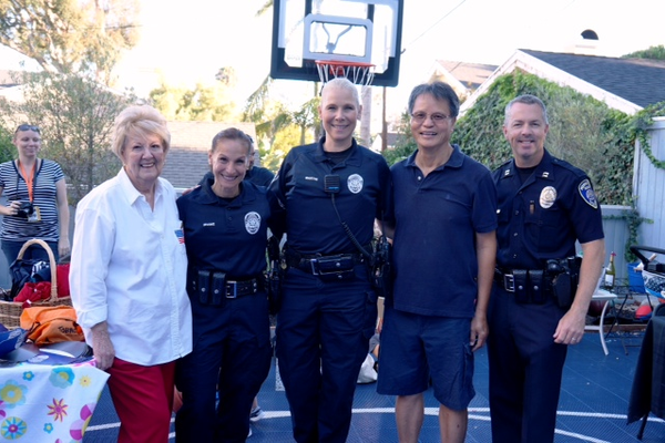 Left to right: MBPD Officer Kelly Benjamin (in back with camera), Victim Assistance Team Volunteer Jeannette Wright, Chief of Police Eve R. Irvine Officer Stephanie Martin, Police Support Volunteer Steve Yi, and MBPD Captain Tim Hageman at one of the National Night Out block gatherings.