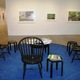 A sitting area with art books is part of the gallery installation.