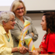 Judy Needham and Tobi Jackson Congratulate Faith Magness. Photo Courtesy Julien and Lambert Photographic Services