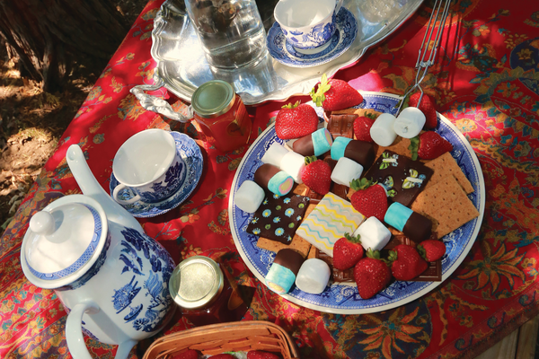 Glamping exudes a certain luxury, such as a beautifully decorated table. (Marshmallow items, fruit and jams provided by California Gourmet Company, californiagourmetcompany.com)