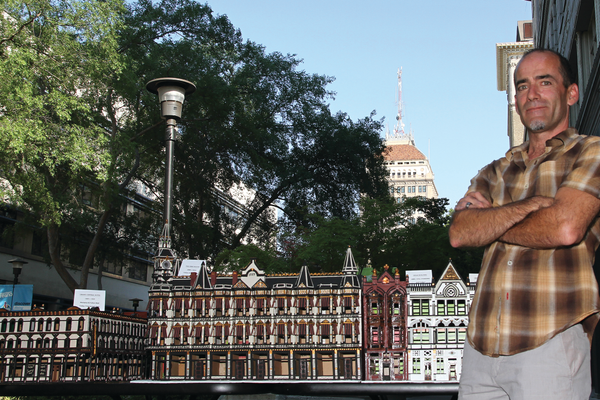 John Rupe with a few of his models on Fulton Mall, including, from left to right, the Grand Central Hotel and the Fiske Block, Helm and Griffith buildings.