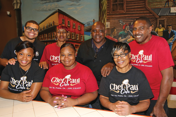 Paul Pearson (back row, second from the right) and a few of the family members and friends who help make Chef Paul's Café the area's hottest soul food restaurant.