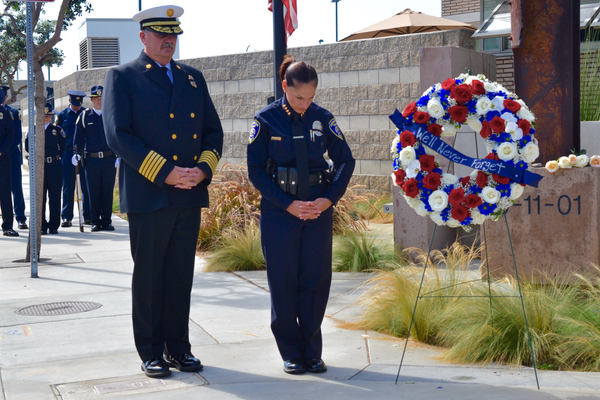 Fire Chief Robert Espinosa and Police Chief Eve Irvine pause for reflection next to the 9/11 memorial on Valley Drive