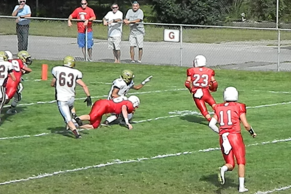 Tyler Ward (23) gets the corner and heads for the end zone.