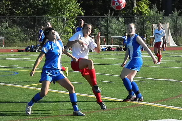 Emily Velozo (24) tracks a ball in the air.