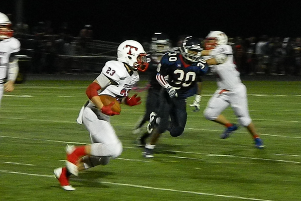 Junior running back Tyler Ward (23) looks for the edge.