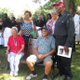 Descendants of Hinsonville families took their place on the bench after the ceremony.