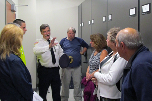 Police Chief Gerry Daigle explains to members of the public how the evidence room functions.