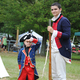 Charlie Megosh, 6, with Michael Ferrante, one of the re-enactors.