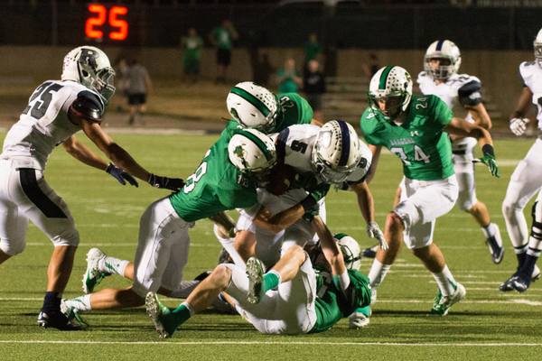 The Dragon defense gang tackles Richland during a 52-21 win at Dragon Stadium. Photo by S. Johnson/ SnappedDragons.com