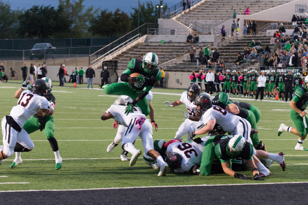 Dragon RB/WR Shemar Coleman leapfrogs over a Panther defender into the end zone for a score. The Dragons defeated Colleyville Heritage 49-14 at Dragon Stadium. Photo by S. Johnson/ SnappedDragons.com