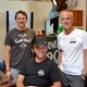 South Bay Mo Bros Sean Gesell and Sandy Goodman, with Movember Foundation CEO Adam Garone (seated) at Bob Roy Salon