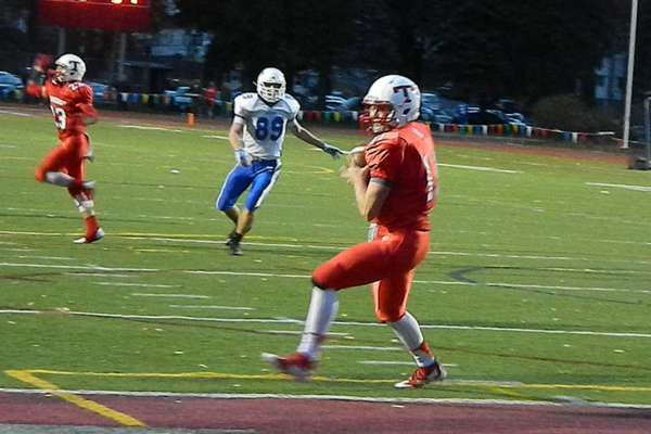 Senior quarterback Brett Morris (11) hauls in a touchdown pass.