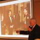 Mark Peterson shows a photo of himself with President Ronald Reagan