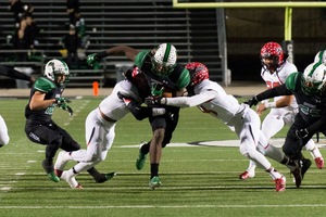 Southlake Carrol RB Lil Jordan Humphrey breaks through the Cedar Hill defense in the first round of the 2015 UIL football playoffs  Humphrey accounted for 289 yards and three TDs as the Dragons defeated Cedar Hill 37-33 at Dragon Stadium  Photo by S JohnsonSnappedDragonscom