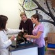 Dr. Lesser and Stephanie Smerdon consult Ben and Gwen Adams on home care for their calico Penny.