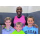 Wizards' point guard Arthur Lewis Jr. poses with Bellingham Memorial Middle School students, from left, Ian Moser, Joshua Esposito, and Mason Moser