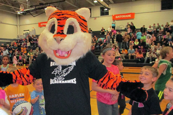 A tiger mascot made his way around the Bellingham High gym during halftime