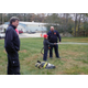 Conor R. uses the fire hose with firefighters Joseph Manning and Peter Washburn.