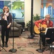 Laura Underwood performs at at the indoor Maple Grove Farmers Market Dec. 2015