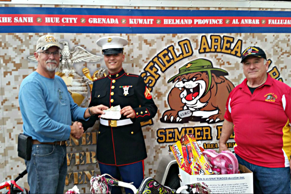 Donating $1500 to Toys for Tots as well as a bunch of toys. Photo courtesy of Andrew Postell.