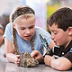 Thumb kids examine rocks
