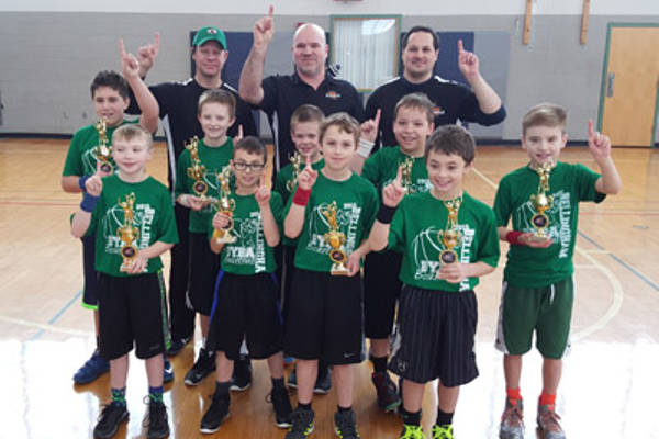 3rd/4th grade Boys Champions—McKeown Plumbing & Heating Back (L-R): Assistant Coach Mike Hughes, Head Coach Scott Magill, Asst Coach George Perkins; middle: Mady Watson, Christian Barry, Ben Hughes, Michael Ferrone;  front: Alex Hughes, Nicolas Perkins, Michael Labaki, Mathew Drons, Corey Magill