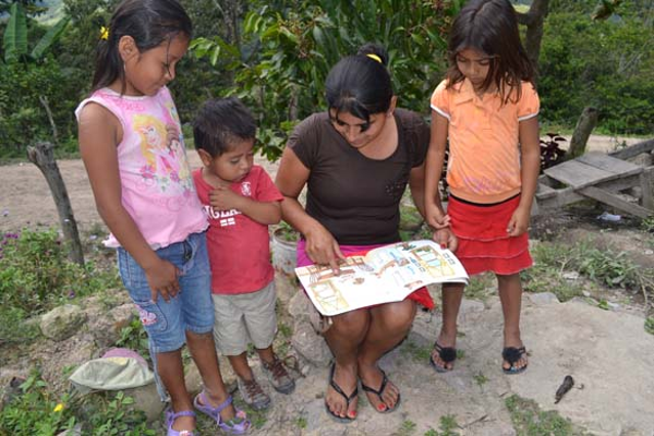 Skill-building can extend to reading projects for the families of Honduran women...