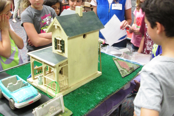 A dollhouse is used to show how runoff happens.