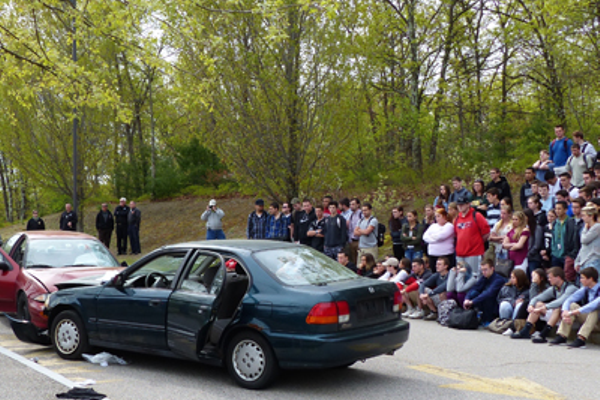 A somber class of 2016 watches the mock accident