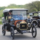 Vintage cars motor through the area as part of a tour - 05312016 1120AM