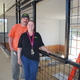 Nick and Cheryl Lacovara by the inside feeding window of Jimmy the giraffes new barn