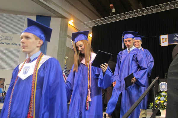 Students descend the steps after getting their diplomas.
