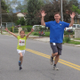 Kindergartner Samantha Chauv finishes the one-mile East Midvale fun run May 6 with Principal Justin Pitcher. She was the first female finisher. —Julie Slama