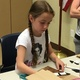"""Nine-year-old Raya Tanner makes a Chewbacca puppet at the South Jordan Youth Council's """"May the Fourth Be With You"""" event. – Tori La Rue"""