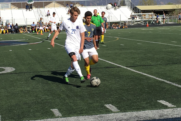 Easton Hopkins dribbles the ball at the Bingham vs. Taylorsville soccer game on April 19. – Tori La Rue