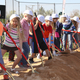 Alta View current and future students take their turns shoveling dirt at the April 19 groundbreaking of the new school, which is expected to open in two years. — Robyn Curtis