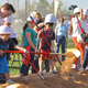 Students help dig dirt for the new two-story Alta View that will be built to the east of the current 53-year-old elementary school. It is being built with money from a $250 million bond approved by voters in 2010. — Robyn Curtis