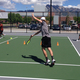 Senior Michael Pond returns a serve during a sunny afternoon practice. Though just three players made it to the State tournament, several players continued to show up for practice after the official season was over to continue improving their skills.