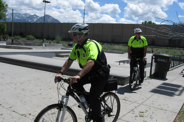 Sergeant Steve Wooldridge rides his bike as Officer Dave Hedrick hops on his to follow at Fairmont Park on May 10. Bike patrols returned to the Sugar House area on May 1. – Travis Barton