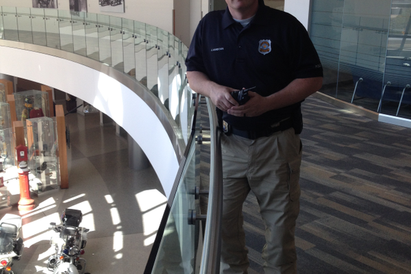 Detective Josh Ashdown pauses at the railing in the police station in downtown Salt Lake City. Ashdown has been part of the police force for 11 years. – Travis Barton