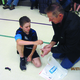 A father and son create a catapult using a plastic spoon and a mousetrap at the Dad and kid Science Night at Columbia Elementary School – Stacey Leavitt