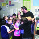 Ronald Squire's second-grade students give him a congratulatory hug for receiving an award from the Jordan Education Foundation. – Jordan School District