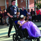 A member of the Riverton High School Peer Leadership Team dances spins a Kari Sue Hamilton Student around in her wheelchair during prom. – Tori La Rue