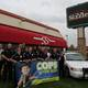 Members of the Sizzler staff and West Valley City Police Department get together for a photo outside Sizzler on Redwood Road on April 21. – West Valley City